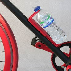 Universal bottle holder for bicycle