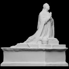 Statue of a kneeling man