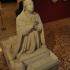 Statue of a kneeling man image
