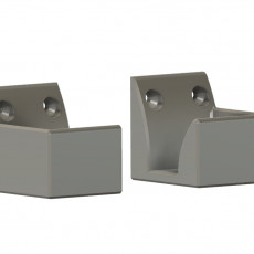 Wall mountable feet for laptop side mount