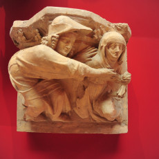 Capital representing two female figures