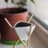 Triangular planter on chopsticks image